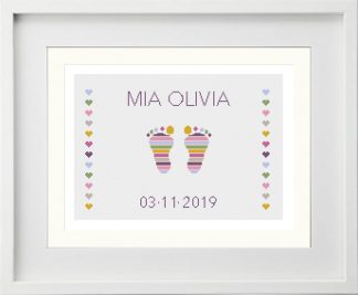 Customisable Pink Baby Feet cross stitch pattern that has been mounted in a white picture frame