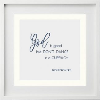 God is good, but don't dance in a currach is an Irish proverb cross stitch pattern shown here completed and framed